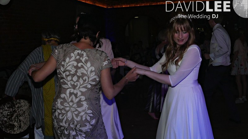Bride dancing with Guests at cheshire Wedding